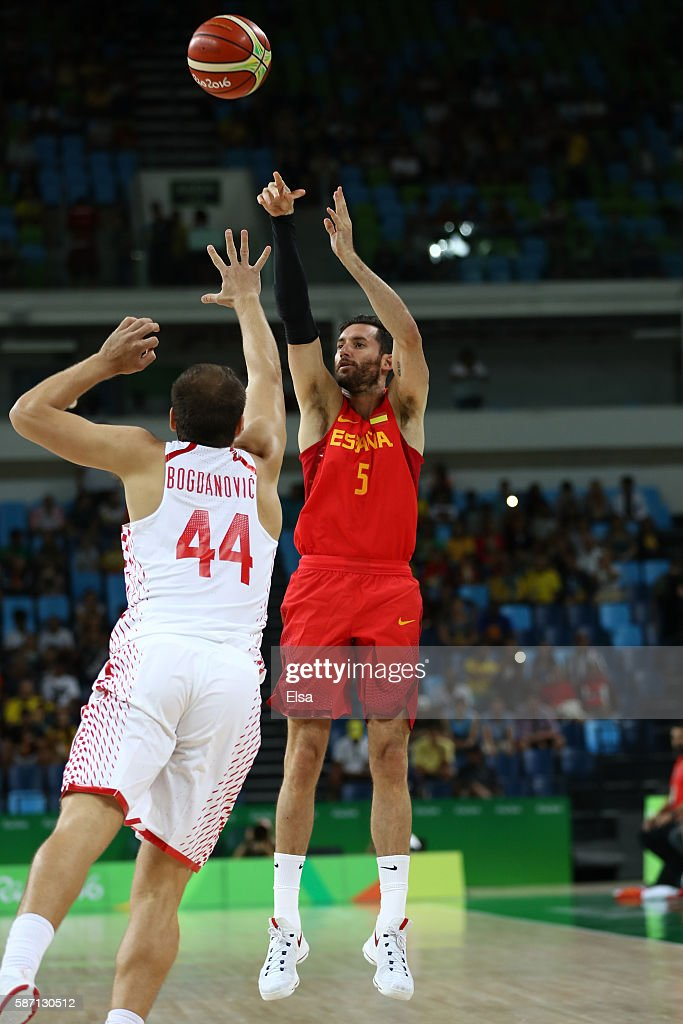 Rudy Fernandez of Spain shoots over Bojan Bogdanovic of Croatia shoots over during a Men's preliminary round basketball game between Croatia and...