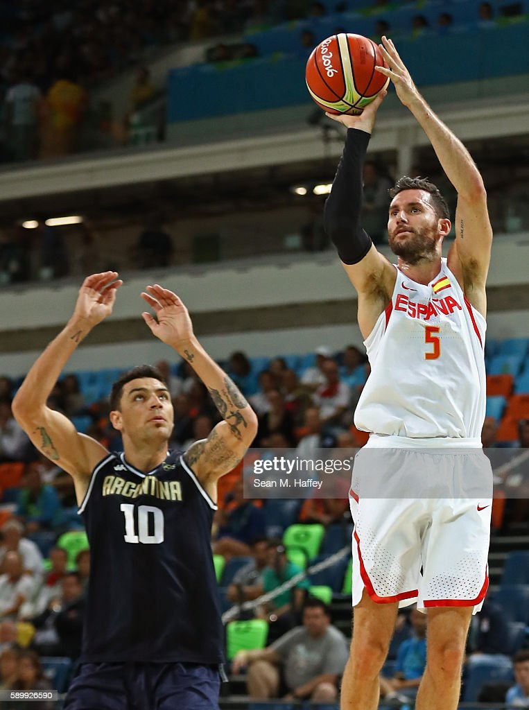 Rudy Fernandez of Spain shoots over Carlos Delfino of Argentina during a Men's Basketball Preliminary Round Group B game between Spain and Argentina...