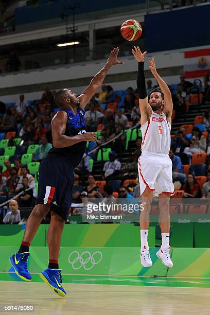 Rudy Fernandez of Spain shoots the ball over Boris Diaw of France during the Men's Quarterfinal match on Day 12 of the Rio 2016 Olympic Games at...