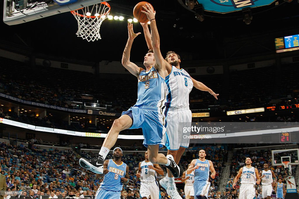 Rudy Fernandez of the Denver Nuggets shoots the ball over Marco Belinelli of the New Orleans Hornets at the New Orleans Arena on January 6 2012 in...