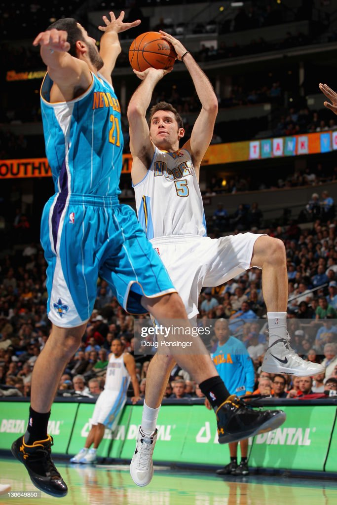 Rudy Fernandez #5 of the Denver Nuggets takes a shot over <a gi-track='captionPersonalityLinkClicked' href=/galleries/search?phrase=Greivis+Vasquez&family=editorial&specificpeople=4066977 ng-click='$event.stopPropagation()'>Greivis Vasquez</a> #21 of the New Orleans Hornets at the Pepsi Center on January 9, 2012 in Denver, Colorado. The Hornets defeated the Nuggets 94-81.