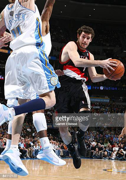 Rudy Fernandez of the Portland Trail Blazers goes to the basket against Chris Andersen of the Denver Nuggets on December 22 2008 at the Pepsi Center...