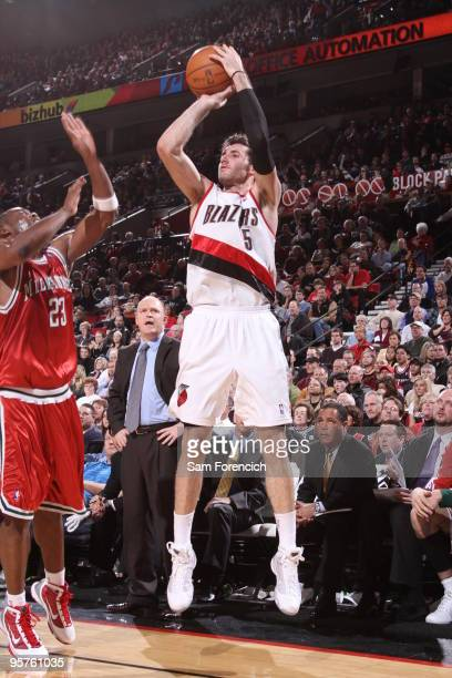 Rudy Fernandez of the Portland Trail Blazers goes up for a shot over Jodie Meeks of the Milwaukee Bucks during a game on January 13 2010 at the Rose...