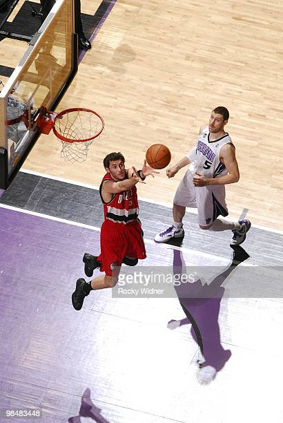 Rudy Fernandez of the Portland Trail Blazers rebounds against Andres Nocioni of the Sacramento Kings during the game at Arco Arena on April 3 2010 in...