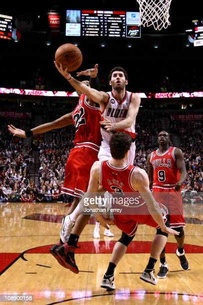 Rudy Fernandez of the Portland Trail Blazers shoots the ball against Omar Asik and Taj Gibson the Chicago Bulls on February 7 2011 at the Rose Garden...
