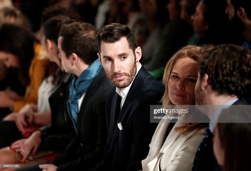 Rudy Fernandez, Real Madrid's Basketball player, looks on as models present creations of David Christian's fall-winter 2016/2017 at the Madrid Fashion Week 2016 on February 9, 2016 in Madrid, Spain.