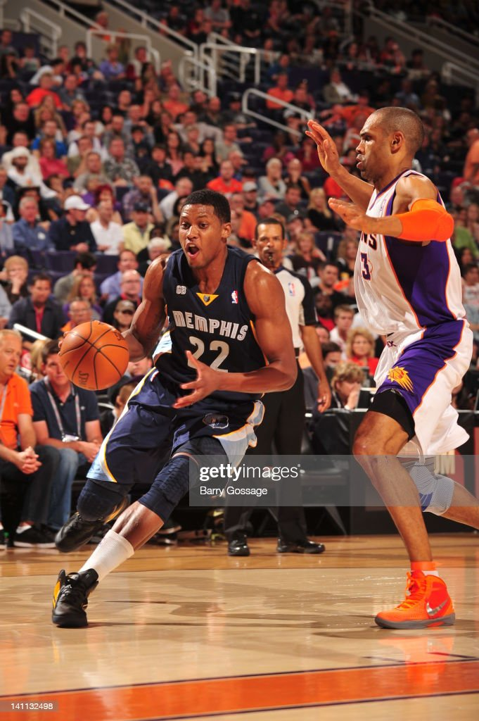 <a gi-track='captionPersonalityLinkClicked' href=/galleries/search?phrase=Rudy+Gay&family=editorial&specificpeople=236066 ng-click='$event.stopPropagation()'>Rudy Gay</a> #22 of the Memphis Grizzlies drives against <a gi-track='captionPersonalityLinkClicked' href=/galleries/search?phrase=Grant+Hill+-+Basketball+Player&family=editorial&specificpeople=201658 ng-click='$event.stopPropagation()'>Grant Hill</a> #33 of the Phoenix Suns in an NBA game played on March 10, 2012 at U.S. Airways Center in Phoenix, Arizona.