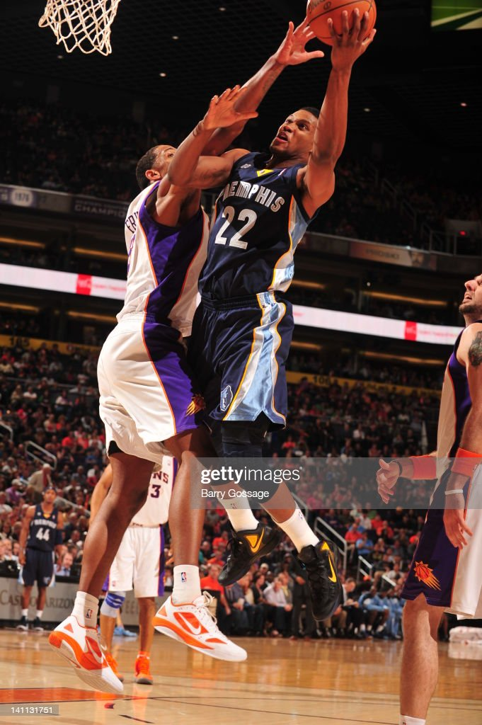 <a gi-track='captionPersonalityLinkClicked' href=/galleries/search?phrase=Rudy+Gay&family=editorial&specificpeople=236066 ng-click='$event.stopPropagation()'>Rudy Gay</a> #22 of the Memphis Grizzlies drives for a shot against <a gi-track='captionPersonalityLinkClicked' href=/galleries/search?phrase=Channing+Frye&family=editorial&specificpeople=206815 ng-click='$event.stopPropagation()'>Channing Frye</a> #8 of the Phoenix Suns in an NBA game played on March 10, 2012 at U.S. Airways Center in Phoenix, Arizona.