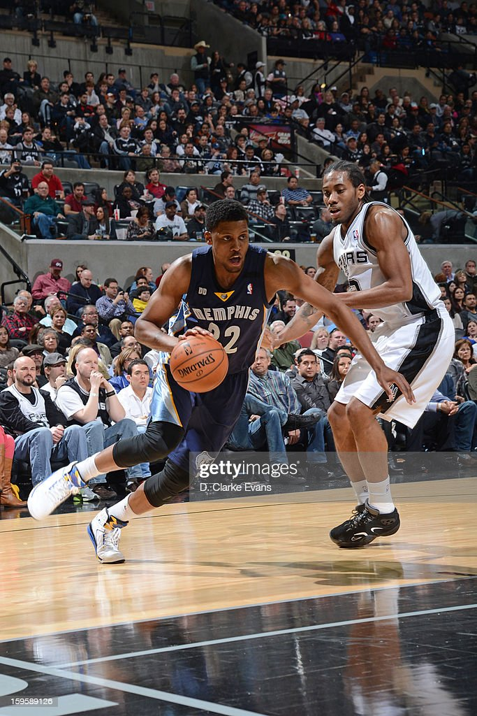 Rudy Gay #22 of the Memphis Grizzlies drives to the basket against Kawhi Leonard #2 of the San Antonio Spurs on January 16, 2013 at the AT&T Center in San Antonio, Texas.