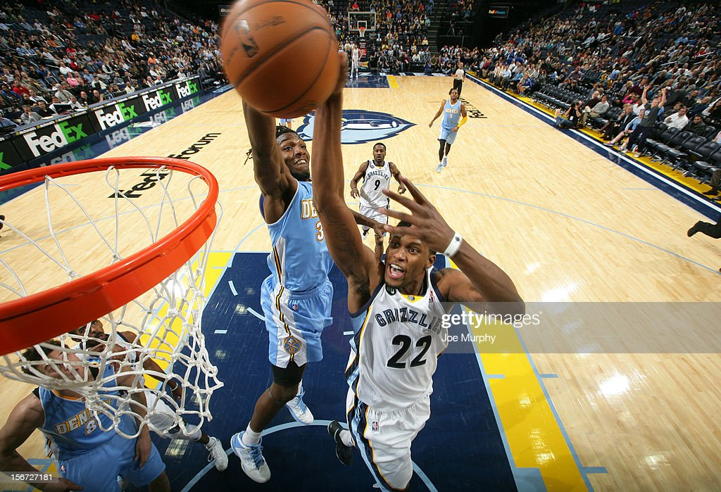 <a gi-track='captionPersonalityLinkClicked' href=/galleries/search?phrase=Rudy+Gay&family=editorial&specificpeople=236066 ng-click='$event.stopPropagation()'>Rudy Gay</a> #22 of the Memphis Grizzlies dunks against <a gi-track='captionPersonalityLinkClicked' href=/galleries/search?phrase=Kenneth+Faried&family=editorial&specificpeople=5765135 ng-click='$event.stopPropagation()'>Kenneth Faried</a> #35 of the Denver Nuggets on November 19, 2012 at FedExForum in Memphis, Tennessee.