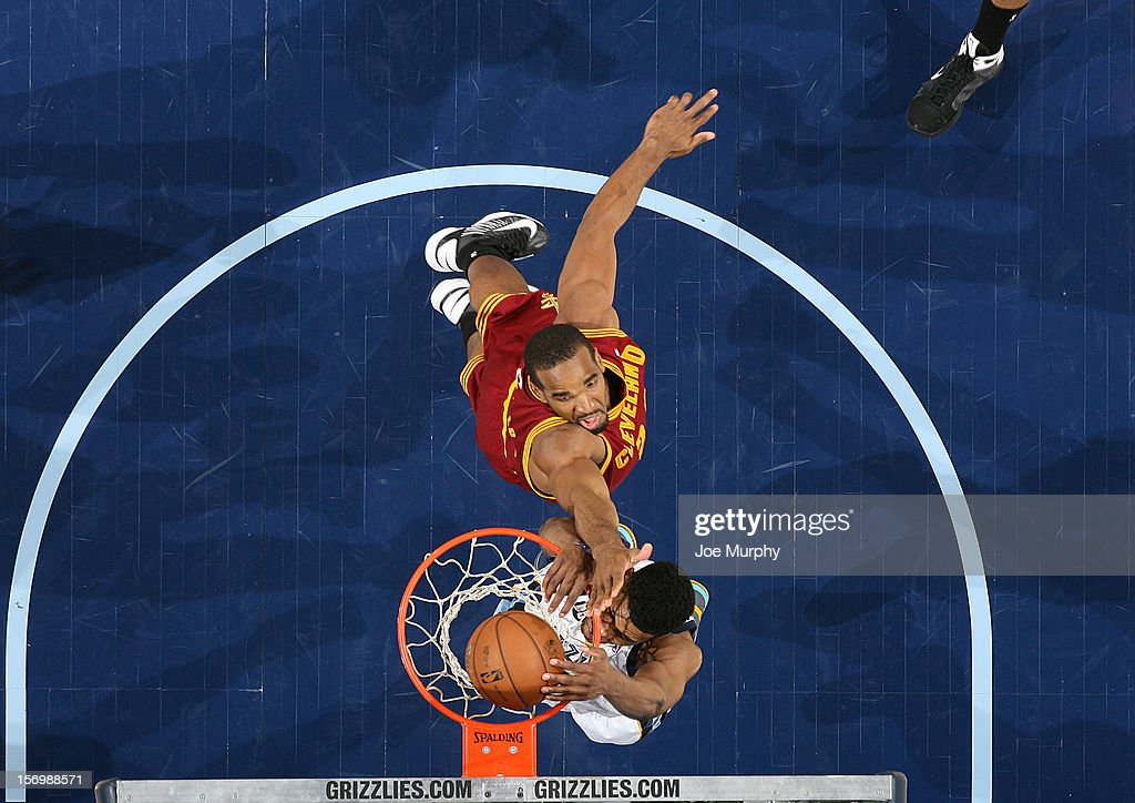 <a gi-track='captionPersonalityLinkClicked' href=/galleries/search?phrase=Rudy+Gay&family=editorial&specificpeople=236066 ng-click='$event.stopPropagation()'>Rudy Gay</a> #22 of the Memphis Grizzlies dunks against <a gi-track='captionPersonalityLinkClicked' href=/galleries/search?phrase=Samardo+Samuels&family=editorial&specificpeople=5042441 ng-click='$event.stopPropagation()'>Samardo Samuels</a> #24 of the Cleveland Cavaliers on November 26, 2012 at FedExForum in Memphis, Tennessee.
