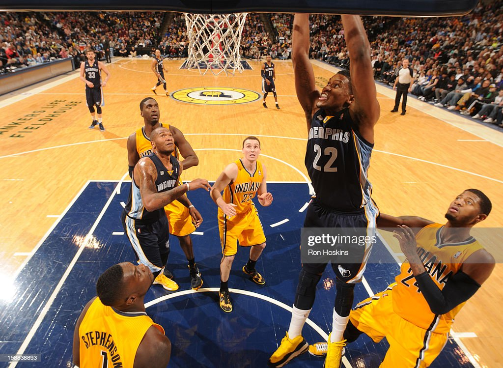 <a gi-track='captionPersonalityLinkClicked' href=/galleries/search?phrase=Rudy+Gay&family=editorial&specificpeople=236066 ng-click='$event.stopPropagation()'>Rudy Gay</a> #22 of the Memphis Grizzlies dunks the ball against the Indiana Pacers on December 31, 2012 at Bankers Life Fieldhouse in Indianapolis, Indiana.