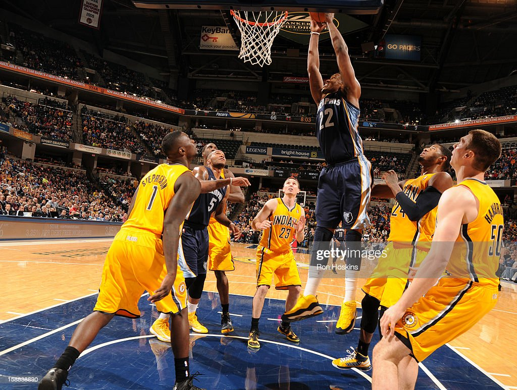 Rudy Gay #22 of the Memphis Grizzlies grabs a rebound against the Indiana Pacers on December 31, 2012 at Bankers Life Fieldhouse in Indianapolis, Indiana.