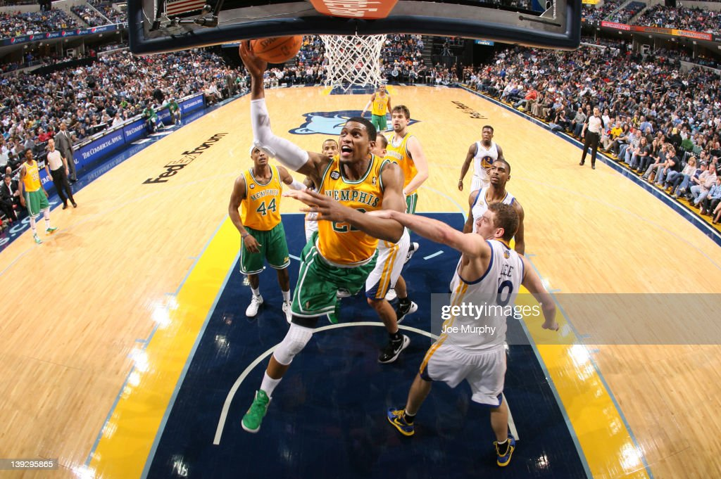 <a gi-track='captionPersonalityLinkClicked' href=/galleries/search?phrase=Rudy+Gay&family=editorial&specificpeople=236066 ng-click='$event.stopPropagation()'>Rudy Gay</a> #22 of the Memphis Grizzlies is fouled by David Lee #10 of the Golden State Warriors while attempting a layup on February 18, 2012 at FedExForum in Memphis, Tennessee.