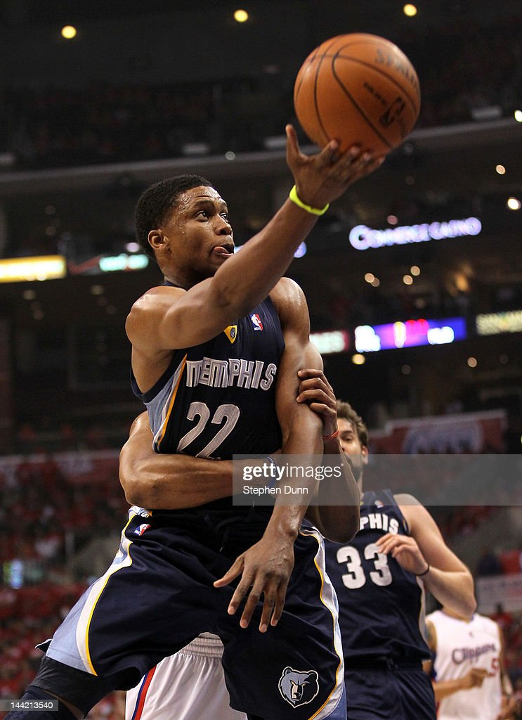 <a gi-track='captionPersonalityLinkClicked' href=/galleries/search?phrase=Rudy+Gay&family=editorial&specificpeople=236066 ng-click='$event.stopPropagation()'>Rudy Gay</a> #22 of the Memphis Grizzlies is fouled by <a gi-track='captionPersonalityLinkClicked' href=/galleries/search?phrase=Randy+Foye&family=editorial&specificpeople=240185 ng-click='$event.stopPropagation()'>Randy Foye</a> #4 of the Los Angeles Clippers as Gay makes the layup in the first quarter in Game Six of the Western Conference Quarterfinals in the 2012 NBA Playoffs on May 11, 2012 at Staples Center in Los Angeles, California.