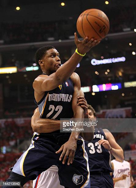 Rudy Gay of the Memphis Grizzlies is fouled by Randy Foye of the Los Angeles Clippers as Gay makes the layup in the first quarter in Game Six of the...