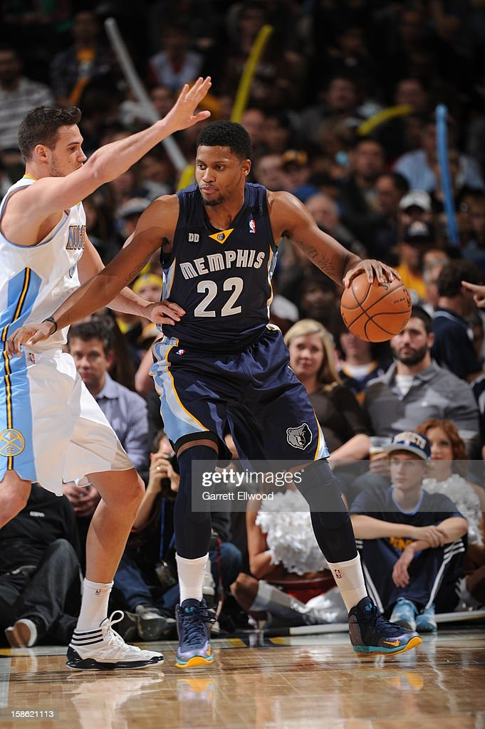 <a gi-track='captionPersonalityLinkClicked' href=/galleries/search?phrase=Rudy+Gay&family=editorial&specificpeople=236066 ng-click='$event.stopPropagation()'>Rudy Gay</a> #22 of the Memphis Grizzlies looks to make a move against <a gi-track='captionPersonalityLinkClicked' href=/galleries/search?phrase=Danilo+Gallinari&family=editorial&specificpeople=4644476 ng-click='$event.stopPropagation()'>Danilo Gallinari</a> #8 of the Denver Nuggets on December 14, 2012 at the Pepsi Center in Denver, Colorado.