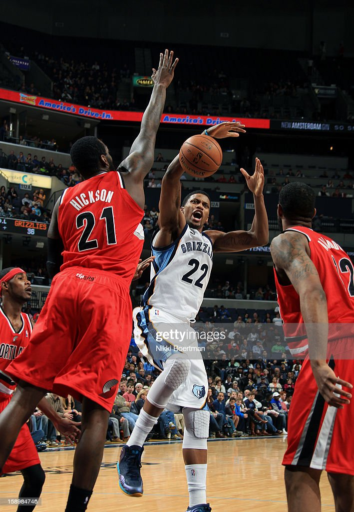 Rudy Gay #22 of the Memphis Grizzlies looses the ball against J.J. Hickson #21 of the Portland Trail Blazers on January 4, 2013 at FedExForum in Memphis, Tennessee.