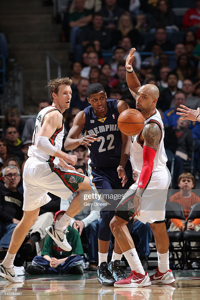 Rudy Gay #22 of the Memphis Grizzlies passes against (L-R) Mike Dunleavy #17 and Drew Gooden #0 of the Milwaukee Bucks on March 31, 2012 at the Bradley Center in Milwaukee, Wisconsin.