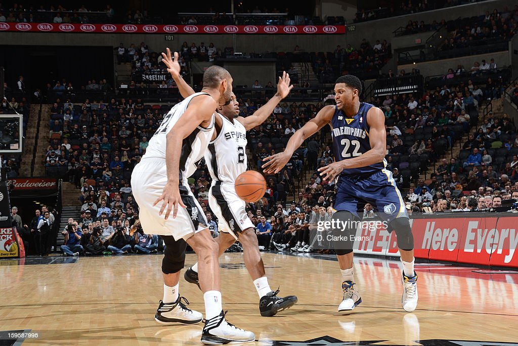 Rudy Gay #22 of the Memphis Grizzlies passes the ball against Kawhi Leonard #2 and Tim Duncan #21 of the San Antonio Spurs on January 16, 2013 at the AT&T Center in San Antonio, Texas.