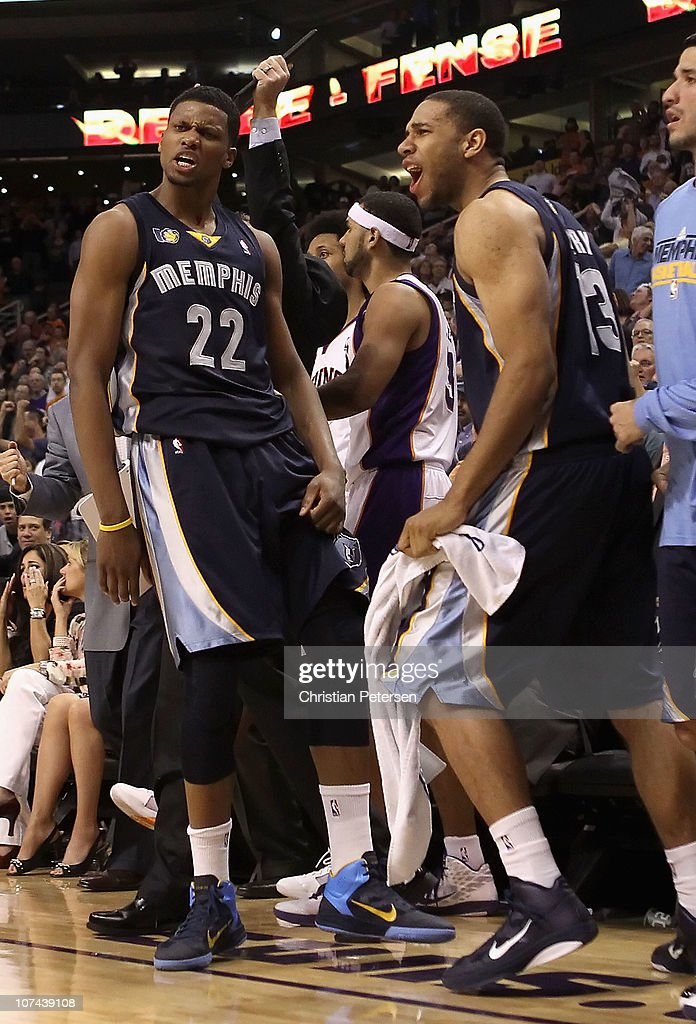 <a gi-track='captionPersonalityLinkClicked' href=/galleries/search?phrase=Rudy+Gay&family=editorial&specificpeople=236066 ng-click='$event.stopPropagation()'>Rudy Gay</a> #22 of the Memphis Grizzlies reacts with <a gi-track='captionPersonalityLinkClicked' href=/galleries/search?phrase=Xavier+Henry&family=editorial&specificpeople=5792007 ng-click='$event.stopPropagation()'>Xavier Henry</a> #13 after Gay hit the game tying three point shot against the Phoenix Suns at the end of regulation in the NBA game at US Airways Center on December 8, 2010 in Phoenix, Arizona. The Grizzlies defeated the Suns 104-98 in overtime.