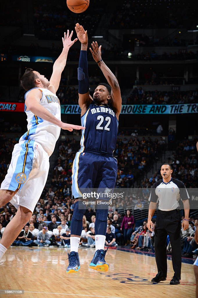 <a gi-track='captionPersonalityLinkClicked' href=/galleries/search?phrase=Rudy+Gay&family=editorial&specificpeople=236066 ng-click='$event.stopPropagation()'>Rudy Gay</a> #22 of the Memphis Grizzlies shoots against <a gi-track='captionPersonalityLinkClicked' href=/galleries/search?phrase=Danilo+Gallinari&family=editorial&specificpeople=4644476 ng-click='$event.stopPropagation()'>Danilo Gallinari</a> #8 of the Denver Nuggets on December 14, 2012 at the Pepsi Center in Denver, Colorado.
