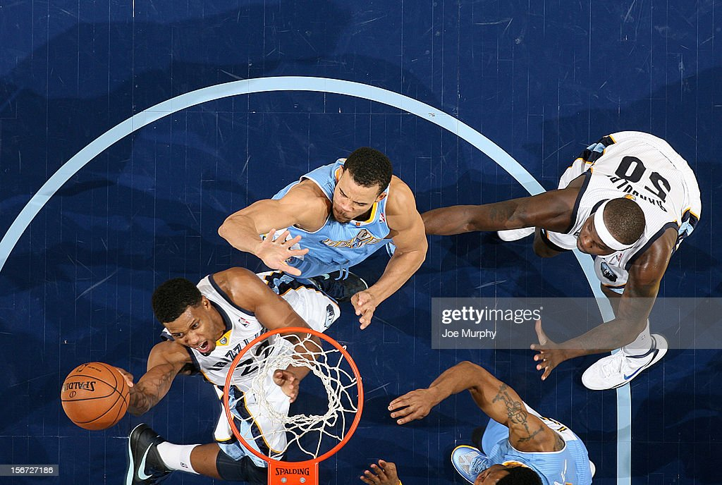 <a gi-track='captionPersonalityLinkClicked' href=/galleries/search?phrase=Rudy+Gay&family=editorial&specificpeople=236066 ng-click='$event.stopPropagation()'>Rudy Gay</a> #22 of the Memphis Grizzlies shoots against <a gi-track='captionPersonalityLinkClicked' href=/galleries/search?phrase=JaVale+McGee&family=editorial&specificpeople=4195625 ng-click='$event.stopPropagation()'>JaVale McGee</a> #34 of the Denver Nuggets on November 19, 2012 at FedExForum in Memphis, Tennessee.