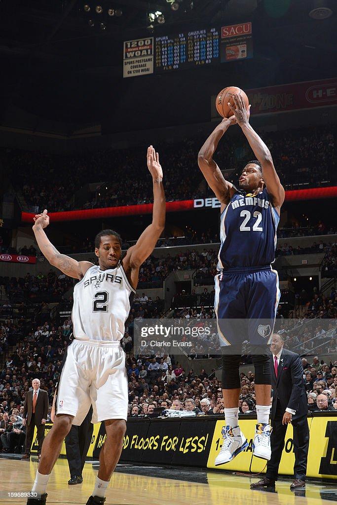Rudy Gay #22 of the Memphis Grizzlies shoots against Kawhi Leonard #2 of the San Antonio Spurs on January 16, 2013 at the AT&T Center in San Antonio, Texas.
