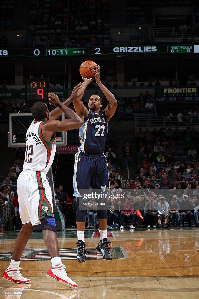 <a gi-track='captionPersonalityLinkClicked' href=/galleries/search?phrase=Rudy+Gay&family=editorial&specificpeople=236066 ng-click='$event.stopPropagation()'>Rudy Gay</a> #22 of the Memphis Grizzlies shoots against <a gi-track='captionPersonalityLinkClicked' href=/galleries/search?phrase=Luc+Richard+Mbah+a+Moute&family=editorial&specificpeople=699041 ng-click='$event.stopPropagation()'>Luc Richard Mbah a Moute</a> #12 of the Milwaukee Bucks on March 31, 2012 at the Bradley Center in Milwaukee, Wisconsin.