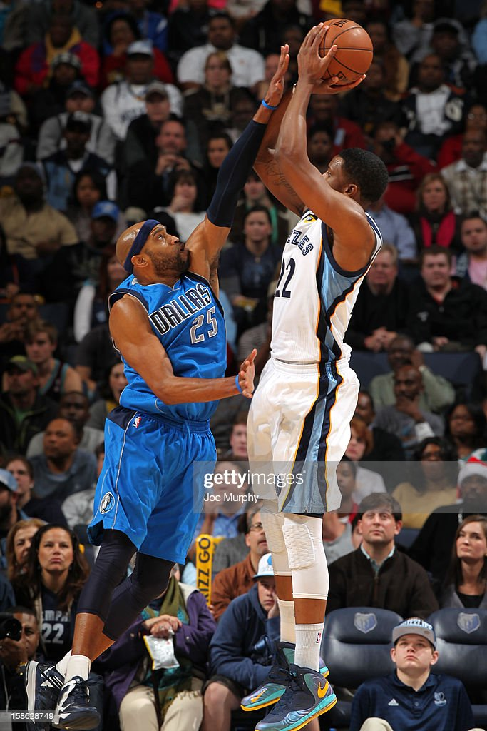 <a gi-track='captionPersonalityLinkClicked' href=/galleries/search?phrase=Rudy+Gay&family=editorial&specificpeople=236066 ng-click='$event.stopPropagation()'>Rudy Gay</a> #22 of the Memphis Grizzlies shoots against <a gi-track='captionPersonalityLinkClicked' href=/galleries/search?phrase=Vince+Carter&family=editorial&specificpeople=201488 ng-click='$event.stopPropagation()'>Vince Carter</a> #25 of the Dallas Mavericks on December 21, 2012 at FedExForum in Memphis, Tennessee.