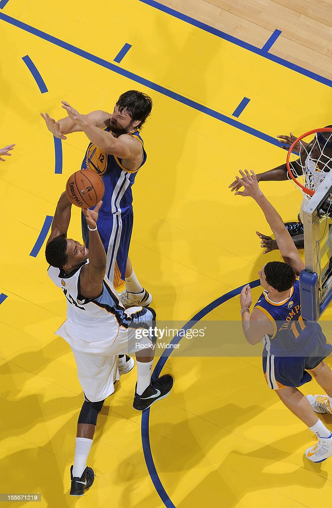 <a gi-track='captionPersonalityLinkClicked' href=/galleries/search?phrase=Rudy+Gay&family=editorial&specificpeople=236066 ng-click='$event.stopPropagation()'>Rudy Gay</a> #22 of the Memphis Grizzlies shoots the ball against <a gi-track='captionPersonalityLinkClicked' href=/galleries/search?phrase=Andrew+Bogut&family=editorial&specificpeople=207105 ng-click='$event.stopPropagation()'>Andrew Bogut</a> #12 and <a gi-track='captionPersonalityLinkClicked' href=/galleries/search?phrase=Klay+Thompson&family=editorial&specificpeople=5132325 ng-click='$event.stopPropagation()'>Klay Thompson</a> #11 of the Golden State Warriors on November 2, 2012 at Oracle Arena in Oakland, California.