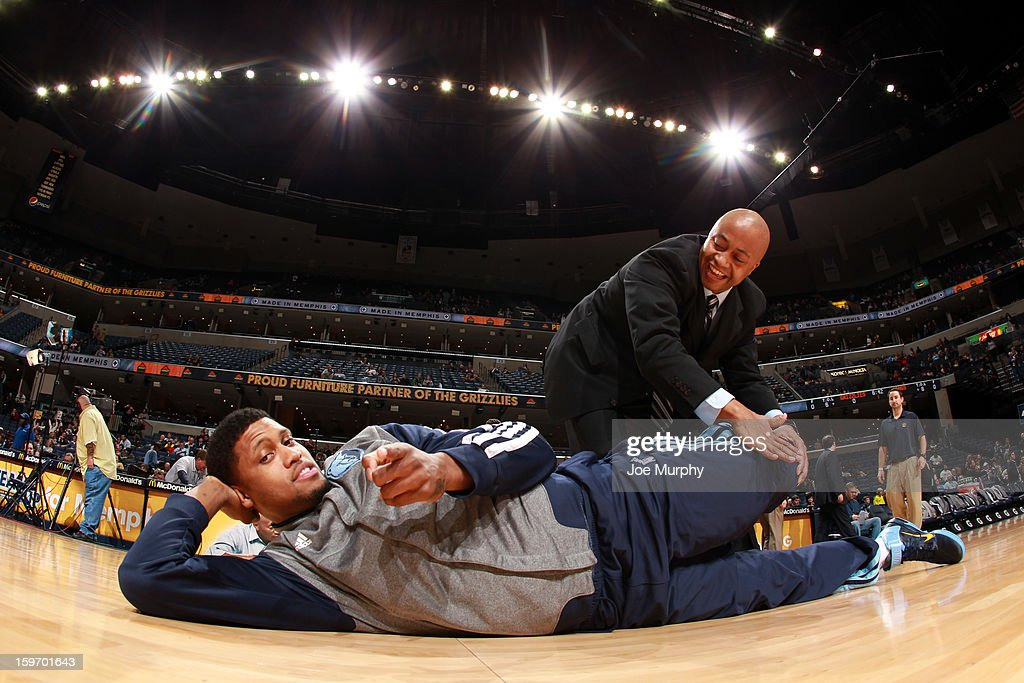 Rudy Gay #22 of the Memphis Grizzlies stretches with a trainer before a game against the Sacramento Kings on January 18, 2013 at FedExForum in Memphis, Tennessee.