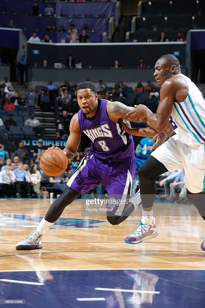 Rudy Gay #8 of the Sacramento Kings drives against Bismack Biyombo #8 of the Charlotte Hornets on March 11, 2015 at Time Warner Cable Arena in Charlotte, North Carolina.