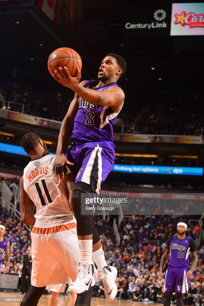 <a gi-track='captionPersonalityLinkClicked' href=/galleries/search?phrase=Rudy+Gay&family=editorial&specificpeople=236066 ng-click='$event.stopPropagation()'>Rudy Gay</a> #8 of the Sacramento Kings drives for a shot against the Phoenix Suns on December 13, 2013 at U.S. Airways Center in Phoenix, Arizona.
