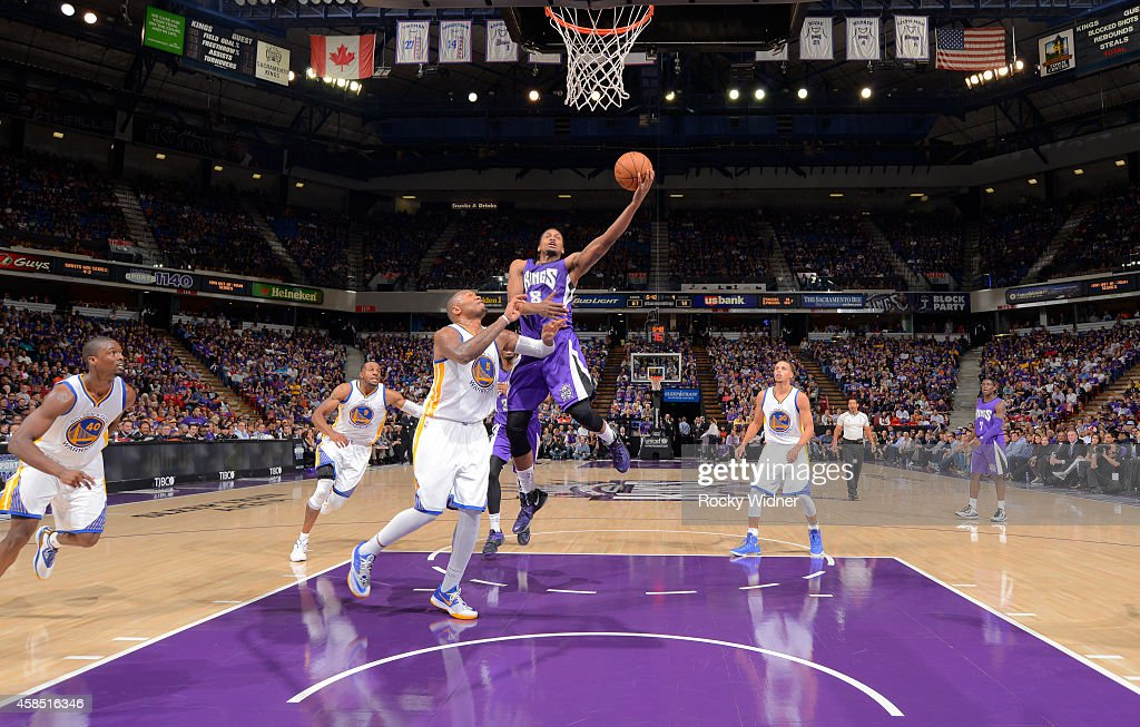 Rudy Gay of the Sacramento Kings goes up for the shot against Marreese Speights of the Golden State Warriors on October 29 2014 at Sleep Train Arena...