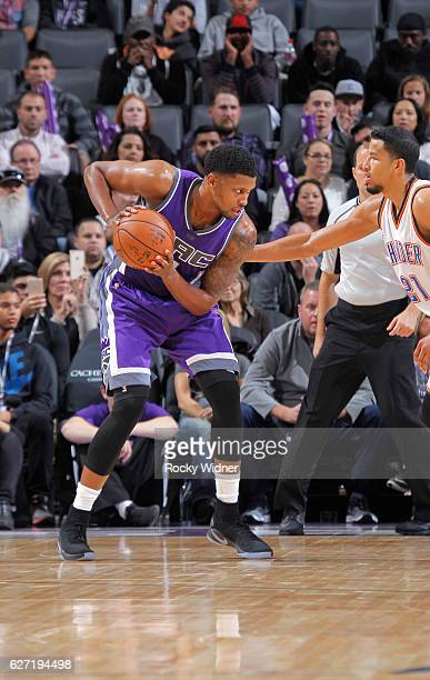 Rudy Gay of the Sacramento Kings handles the ball against Andre Roberson of the Oklahoma City Thunder on November 23 2016 at Golden 1 Center in...