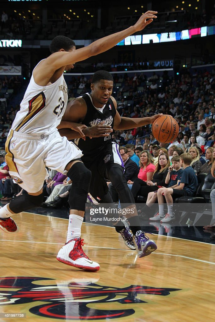 <a gi-track='captionPersonalityLinkClicked' href=/galleries/search?phrase=Rudy+Gay&family=editorial&specificpeople=236066 ng-click='$event.stopPropagation()'>Rudy Gay</a> #8 of the Sacramento Kings handles the ball against the New Orleans Pelicans during an NBA game on March 31, 2014 at the Smoothie King Center in New Orleans, Louisiana.