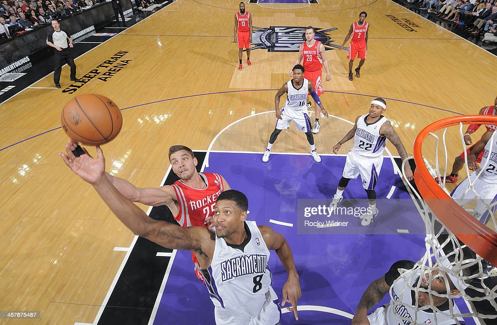 <a gi-track='captionPersonalityLinkClicked' href=/galleries/search?phrase=Rudy+Gay&family=editorial&specificpeople=236066 ng-click='$event.stopPropagation()'>Rudy Gay</a> #8 of the Sacramento Kings rebounds against <a gi-track='captionPersonalityLinkClicked' href=/galleries/search?phrase=Chandler+Parsons&family=editorial&specificpeople=4249869 ng-click='$event.stopPropagation()'>Chandler Parsons</a> #25 of the Houston Rockets on December 15, 2013 at Sleep Train Arena in Sacramento, California.