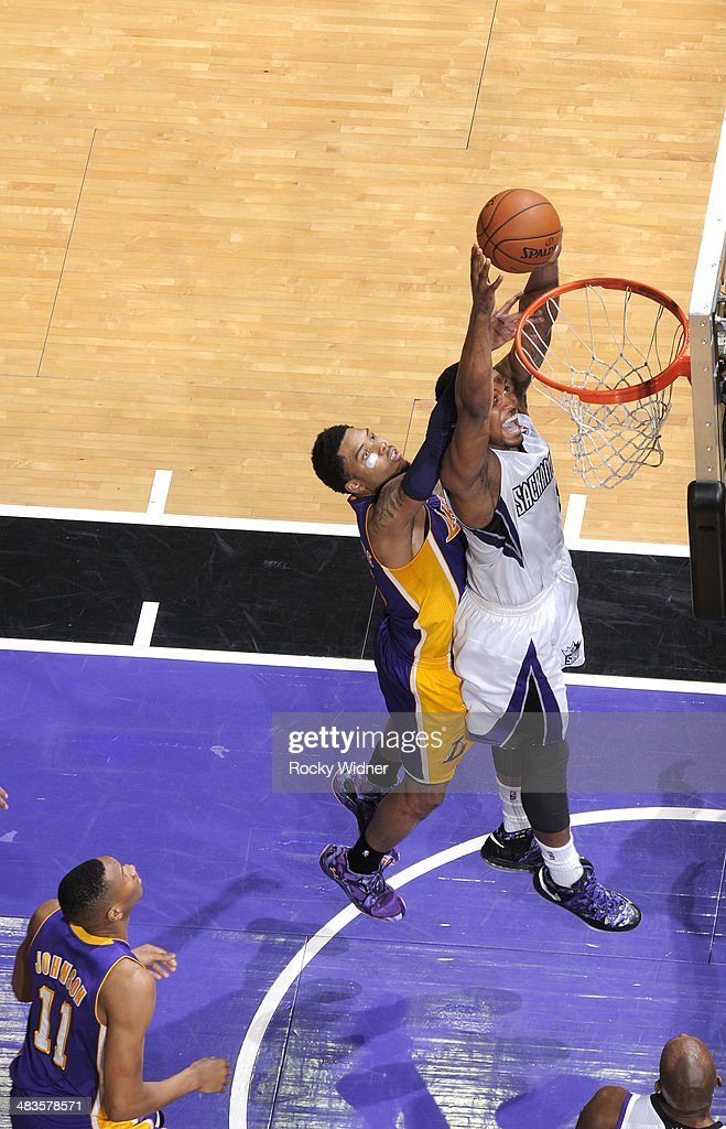 <a gi-track='captionPersonalityLinkClicked' href=/galleries/search?phrase=Rudy+Gay&family=editorial&specificpeople=236066 ng-click='$event.stopPropagation()'>Rudy Gay</a> #8 of the Sacramento Kings rebounds against <a gi-track='captionPersonalityLinkClicked' href=/galleries/search?phrase=Kent+Bazemore&family=editorial&specificpeople=6846101 ng-click='$event.stopPropagation()'>Kent Bazemore</a> #6 of the Los Angeles Lakers on April 2, 2014 at Sleep Train Arena in Sacramento, California.