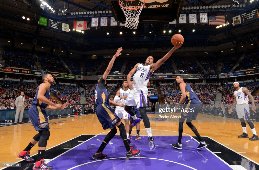 <a gi-track='captionPersonalityLinkClicked' href=/galleries/search?phrase=Rudy+Gay&family=editorial&specificpeople=236066 ng-click='$event.stopPropagation()'>Rudy Gay</a> #8 of the Sacramento Kings shoots a layup against Anthony Davis #23 of the New Orleans Pelicans on March 3, 2014 at Sleep Train Arena in Sacramento, California.