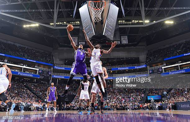 Rudy Gay of the Sacramento Kings shoots a layup against Jerami Grant of the Oklahoma City Thunder on November 23 2016 at Golden 1 Center in...