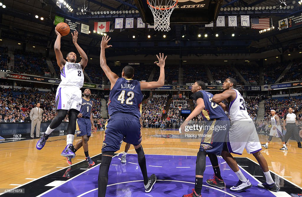 <a gi-track='captionPersonalityLinkClicked' href=/galleries/search?phrase=Rudy+Gay&family=editorial&specificpeople=236066 ng-click='$event.stopPropagation()'>Rudy Gay</a> #8 of the Sacramento Kings shoots against <a gi-track='captionPersonalityLinkClicked' href=/galleries/search?phrase=Alexis+Ajinca&family=editorial&specificpeople=2299006 ng-click='$event.stopPropagation()'>Alexis Ajinca</a> #42 of the New Orleans Pelicans on March 3, 2014 at Sleep Train Arena in Sacramento, California.