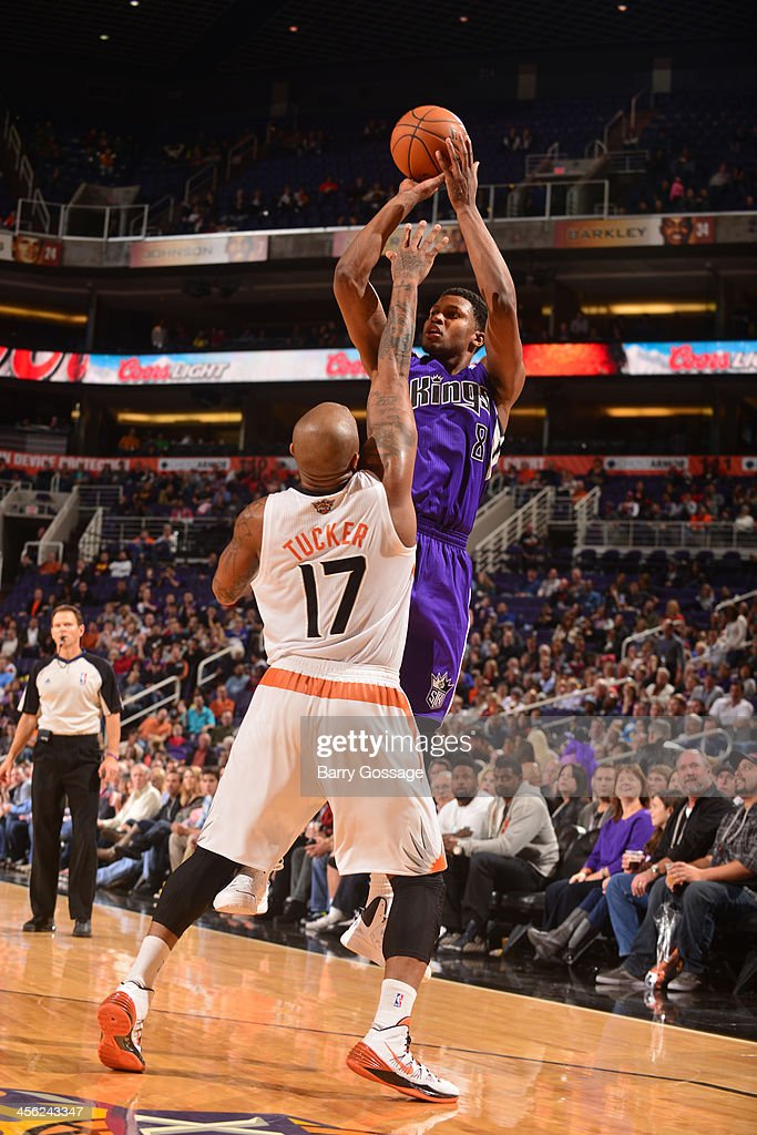 <a gi-track='captionPersonalityLinkClicked' href=/galleries/search?phrase=Rudy+Gay&family=editorial&specificpeople=236066 ng-click='$event.stopPropagation()'>Rudy Gay</a> #8 of the Sacramento Kings shoots over <a gi-track='captionPersonalityLinkClicked' href=/galleries/search?phrase=P.J.+Tucker&family=editorial&specificpeople=227316 ng-click='$event.stopPropagation()'>P.J. Tucker</a> #17 of the Phoenix Suns on December 13, 2013 at U.S. Airways Center in Phoenix, Arizona.