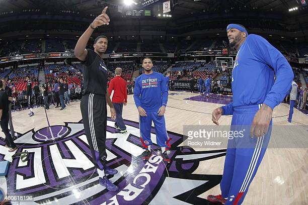 Rudy Gay of the Sacramento Kings speaks with DJ Augustin and Josh Smith of the Detroit Pistons prior to the game on December 13 2014 at Sleep Train...