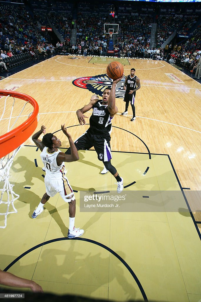 <a gi-track='captionPersonalityLinkClicked' href=/galleries/search?phrase=Rudy+Gay&family=editorial&specificpeople=236066 ng-click='$event.stopPropagation()'>Rudy Gay</a> #8 of the Sacramento Kings takes a shot against the New Orleans Pelicans during an NBA game on March 31, 2014 at the Smoothie King Center in New Orleans, Louisiana.