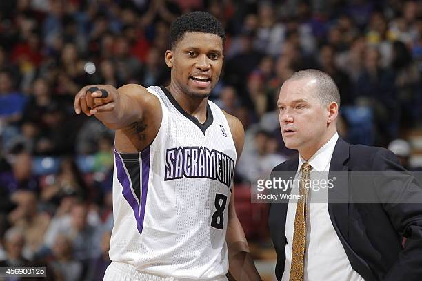 Rudy Gay of the Sacramento Kings talks with head coach Michael Malone during a break in action against the Houston Rockets at Sleep Train Arena on...