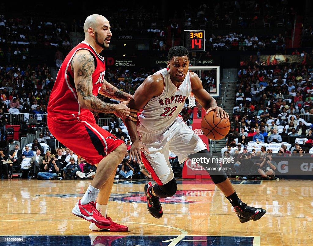 <a gi-track='captionPersonalityLinkClicked' href=/galleries/search?phrase=Rudy+Gay&family=editorial&specificpeople=236066 ng-click='$event.stopPropagation()'>Rudy Gay</a> #22 of the Toronto Raptors drives to the basket against the Atlanta Hawks on November 1, 2013 at Philips Arena in Atlanta, Georgia.