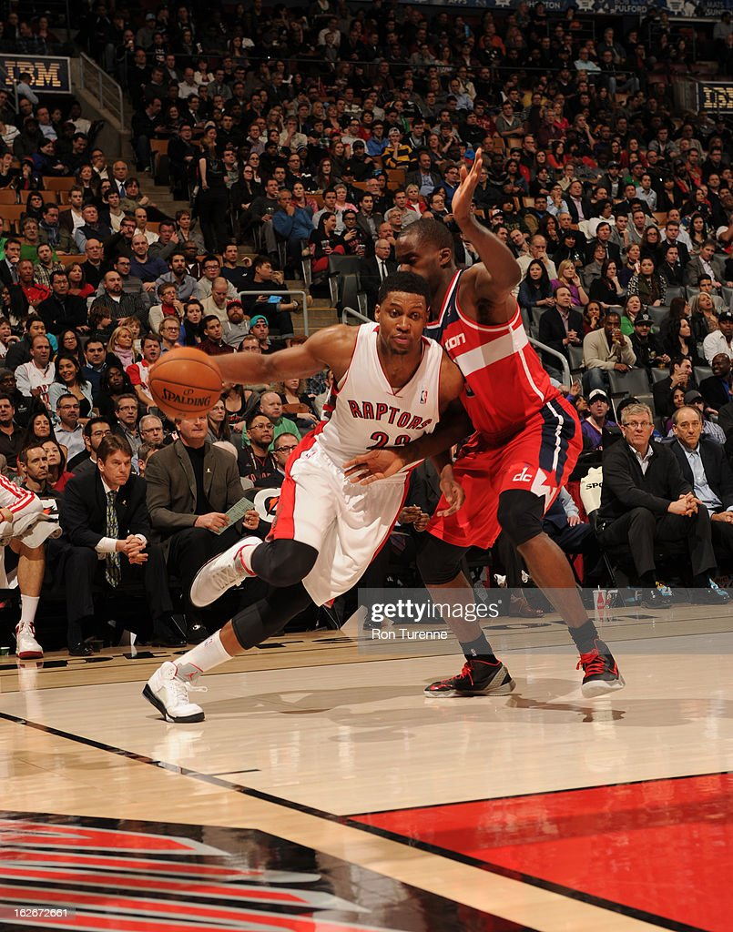 <a gi-track='captionPersonalityLinkClicked' href=/galleries/search?phrase=Rudy+Gay&family=editorial&specificpeople=236066 ng-click='$event.stopPropagation()'>Rudy Gay</a> #22 of the Toronto Raptors drives under pressure during the game between the Toronto Raptors and the Washington Wizards during the game on February 25, 2013 at the Air Canada Centre in Toronto, Ontario, Canada.