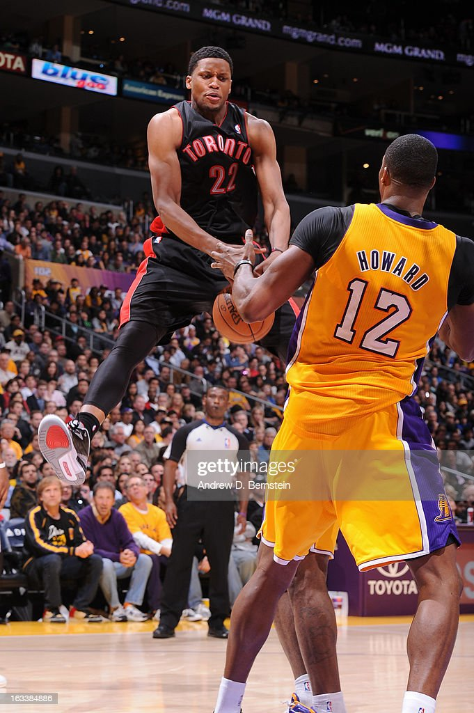 Rudy Gay #22 of the Toronto Raptors loses control of the ball while being guarded by Dwight Howard #12 of the Los Angeles Lakers at Staples Center on March 8, 2013 in Los Angeles, California.