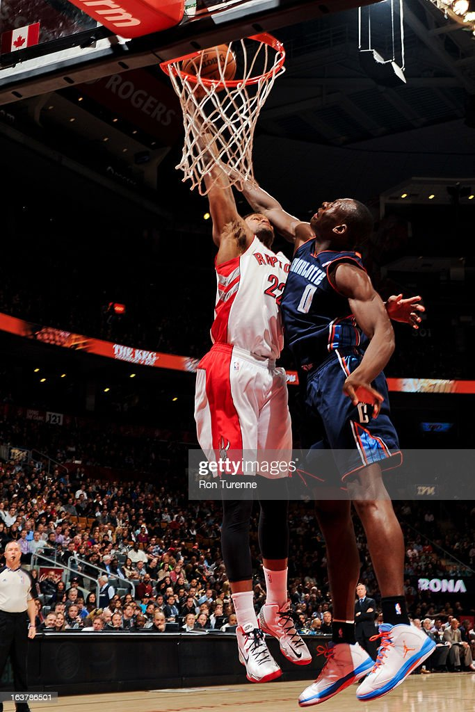 Rudy Gay #22 of the Toronto Raptors rises for a dunk against Bismack Biyombo #0 of the Charlotte Bobcats on March 15, 2013 at the Air Canada Centre in Toronto, Ontario, Canada.